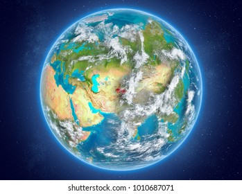 Tajikistan in red on model of planet Earth with clouds and atmosphere in space. 3D illustration. Elements of this image furnished by NASA.