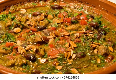 Tajine lamb with ginger, garlic, onion, olives, almonds and tomatoes