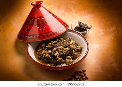 tajine with meat plum almond and sesame seeds
