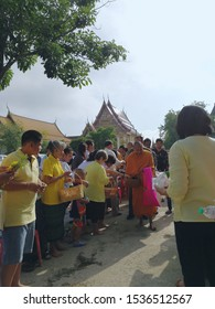 Tak Bat Devo Festival:Ratchaburi, Thailand -October 25, 2019: Tak Bat Devo Rohana is a Buddhist festival offering food to monks on the end of Buddhist Lent on October 15, 2019 in Ratchaburi, Thailand.