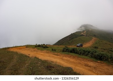 TAK, THAILAND - DECEMBER 31, 2018 : Off road vehicle. Off road gravel road with fog and mist in Wildlife Sanctuary in Tak, Thailand.