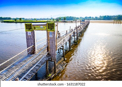 TAK, THAILAND - January 26, 2020 : Bamboo bridge over the Ping river at Ban Tak district, Tak province.