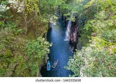 Takachiho gorge with Manai waterfall and boat in Miyazaki, Japan.