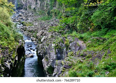 Takachiho Gorge, a narrow chasm cut through the rock by Gokase River with nearly sheer cliffs lining the gorge are made of slow forming volcanic basalt columns, Takachiho, Nishiusuki, Miyazaki, Japan