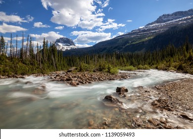 Takakkaw Falls in Yoho National Park during a vibrant sunny summer day. Located in British Columbia, Canada.