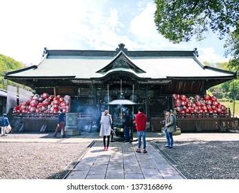 Takasaki Gunma Japan , Apr 2018 , Shorinzan Daruma-ji Temple (Daruma Doll Temple) , tourist burning incense for worship