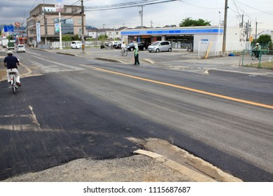 Takatsuki city, Osaka, Japan. June 19 2018 AM10: A collapse road restored after sinkhole. The road collapsed for a water pipe burst and crack in the ground by earthquake hits Osaka.