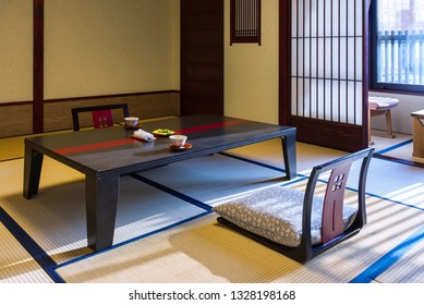 Takayama, Japan - April 25, 2014: The room interior of a ryokan. A ryokan  is a type of traditional Japanese inn that typically feature tatami-matted rooms and communal baths and other public areas