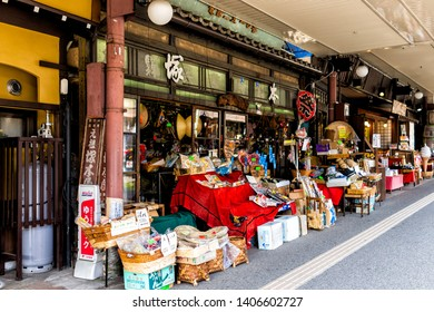 Takayama, Japan - April 6, 2019: Gifu prefecture in Japan with traditional wooden houses on street and display of local goods at store shop