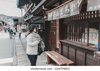 Takayama, Japan - April 9, 2017: Tourist Waudering on a street with Traditional Vintage style store in Sanmachi Suji in Takayama, one of the most popular tourist destination.