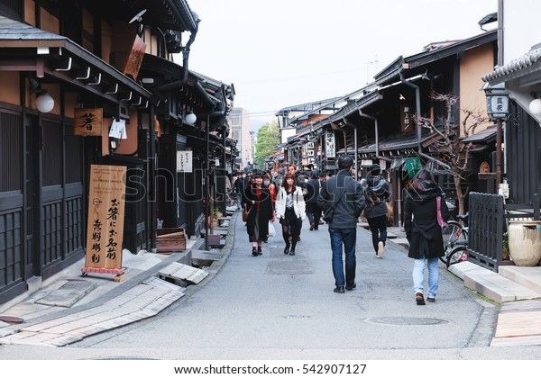 TAKAYAMA, JAPAN - DECEMBER 9: Unidentified people at Sannomachi Street, the old town area which has museums and old private houses, some survive from Edo period on December 9, 2016 in Takayama, Japan.