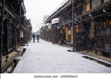 Takayama, Japan - February 12, 2017 : Tourist walking at Takayama Old Town Street in winter snow.
