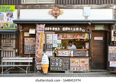Takayama, Japan - November 4, 2019: A man is selling local food and snack long the street in near Takayama old town, Japan