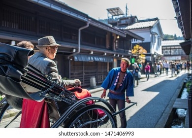 Takayama, Japan: October 21, 2018:  A rickshaw (also known in Japan as a Jinrikisha), or two-wheeled vehicle which seats one to two people and is powered by a person.  Rickshaws are popular in Japan.
