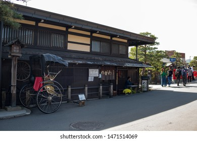 Takayama, Japan: October 21, 2018:  Tourists visiting the Old City of Takayama, Japan, which is best known for its very well-preserved Edo-style buildings.  Takayama is a popular tourist destination.