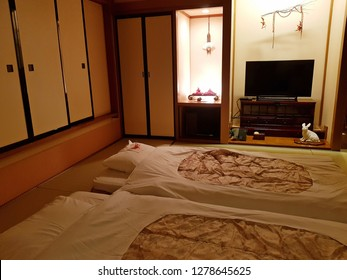 Takayama,Japan-Circa September 2017: Inside the private guest room at a ryokan,Japanese style inn, the traditional futon beds lay out on the tatami floor ready for guests to sleeping at night.