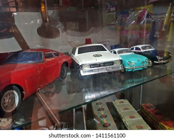 Takayama,Japan-Circa September 2018: Vintage miniature collectible cars show on shelf of local museum at day that reminds people to think about good old days and childhood toys.