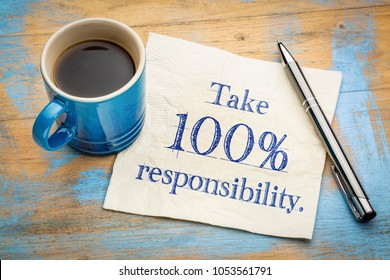 Take 100% responsibility reminder note - handwriting on a napkin
