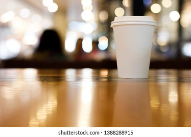 take away coffee cup empty blank copy space for your design text or banner of brand, hot drink on wood table in cafe shop restaurant with light decor celebration party, image used retro vintage filter