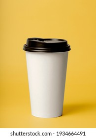 take away coffee on color background