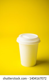 Take away coffee on yellow background