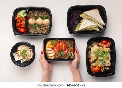 Take away of fitness meal. Healthy food day ration in boxes, restaurant delivery, top view