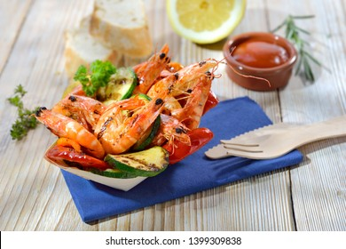 Take away food: Grilled king prawns with mixed vegetables served in a wooden disposable boat