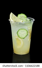 Take away glass with lemon and cucumber lemonade isolated on black