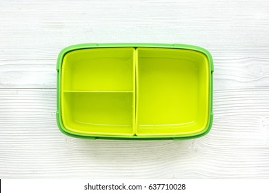 take away with green lunchbox on white background top view