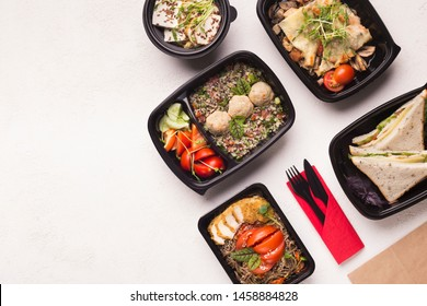 Take away healthy food in black boxes for diet nutrition on white background, copy space