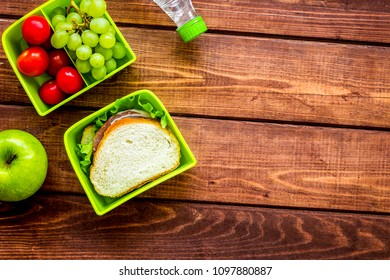 take away with lunchbox and fresh food on wooden background top