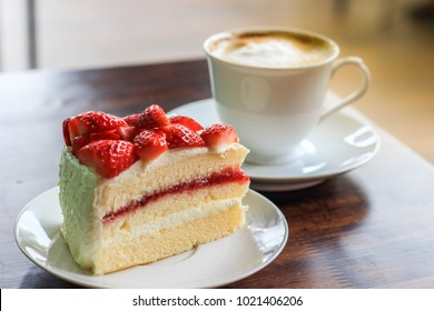 Take a break with   strawberry cheesecake and hot chocolate in coffee shop