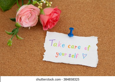 Take care of your self message - Hand writing text on cork board