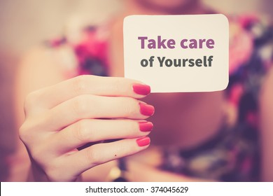 """ Take care of yourself "" - text card on female hand"