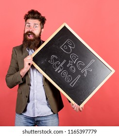 Take it easy. Teacher bearded man holds blackboard with inscription back to school red background. Teacher with tousled hair stressful about school year beginning. Teaching stressful occupation.
