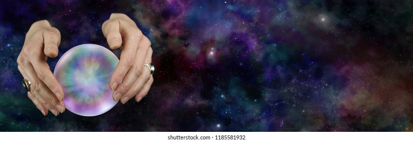 Take a look at the future with a Crystal Ball Reading - female hands hovering over a large scrying ball against a deep space background with plenty of copy space on the right