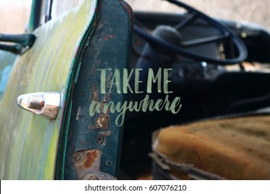 """Take Me anywhere"" quote; old truck with door open"