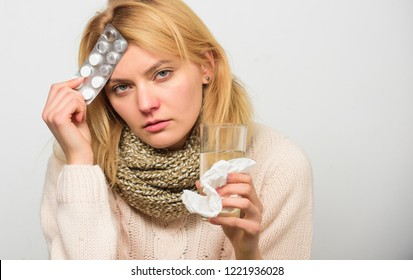 Take medications to reduce fever. Woman tousled hair scarf hold tablets blister. Guidelines for treating fever. Best fever reducer. Girl suffer headache and take medicine. Headache and fever remedies.
