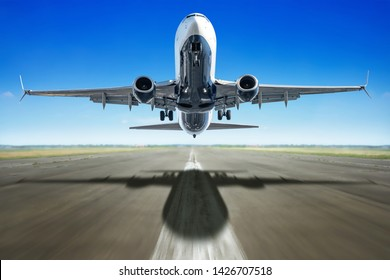 take off of an modern airliner against a blue sky