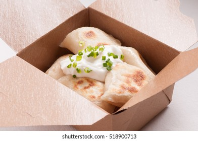 take out pierogi or perogie with sour cream, food truck style