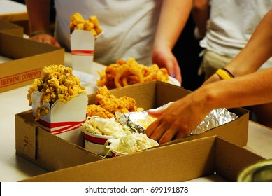 Take out restaurant workers scramble to complete the order quickly and accurately
