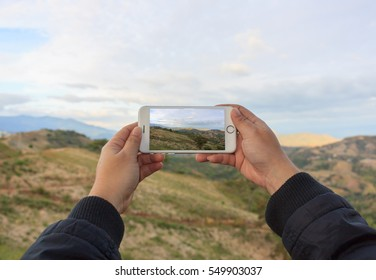 Take photo by Mobile Phone , Tourist Taking Picture of the mount