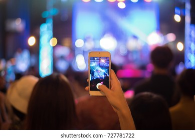 Take photo concert in front of stage.