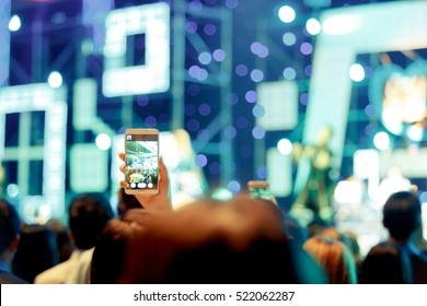 Take photo crowd in front of concert stage