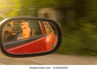 I take photo from inside the car to the mirror side in afternoon sunset and summe time for travel holiday