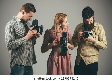 Take a picture, capture the magic. Retro style woman and men hold analog cameras. Paparazzi or photojournalists with vintage old cameras. Group of photographers with retro cameras. Photography studio.