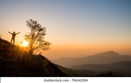 Take a picture of the morning sunrise at the top of a hill in the new day.
