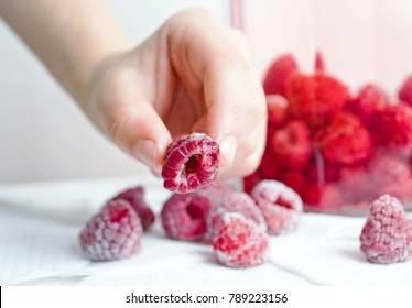 take raspberries by hand