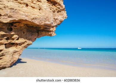 take a rest at secret beach and blue sea ,coral bay australia