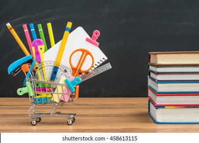take school supplies in shopping cart with textbook for education